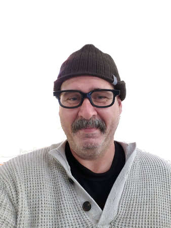 Mustached man wearing black glasses, brown knit hat, and cream sweater isolated Stock Photo