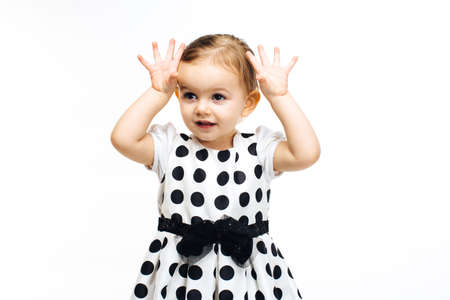 toddler girl with hands up showing ten fingers