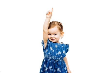 preschool toddler girl raising hand with index finger pointing up 스톡 콘텐츠