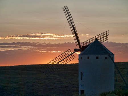Old Windmills at sunset in La Mancha Stock Photo