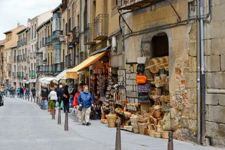 Segovia, Spain - May 5, 2012: Tourists visiting the typical area for shopping, with lots of souvenirs shops in a very crwoded area.