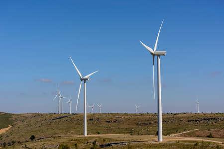 Wind turbines farm in line in Albacete Spain