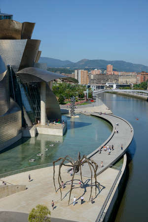 Guggenheim Bilbao museum pedestrian area in a sunny day