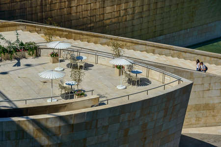 Terrace for coffe at Guggenheim Bilbao area with umbrellas