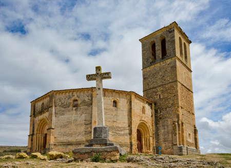 Vera Cruz church in Segovia Spain with a Christian cross in front