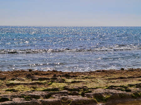 Mediterranean sea at noon with bright sun reflections