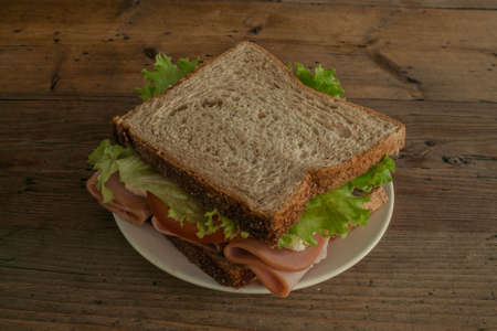 Sandwich with ham and vegetables. Stock fotó