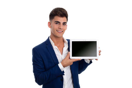 young smiling businessman showing a tablet mobile