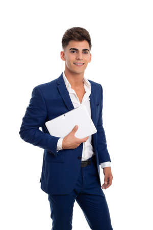 young smiling businessman carrying a tablet mobile Stock fotó