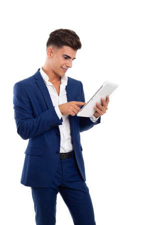 young smiling businessman using a tablet mobile