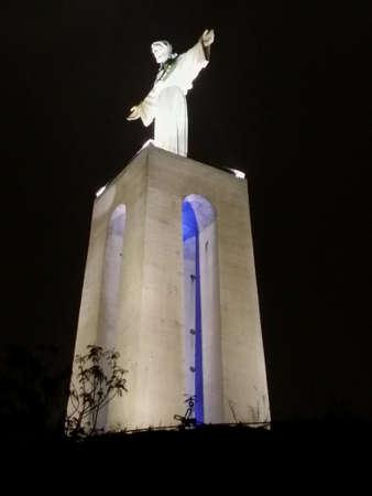 rei: The Cristo rei monument illuminated in portugal almada Stock Photo