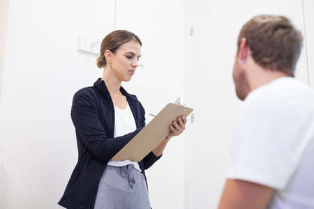female physiotherapist consults young patient