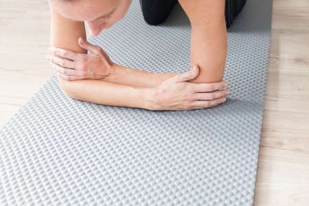 Close up Sporty woman practicing yoga in a yoga mat