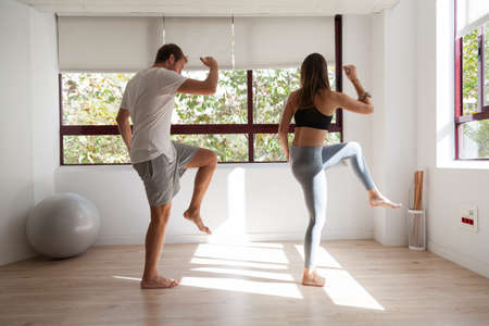 One young couple doing exercise at the gym Stockfoto
