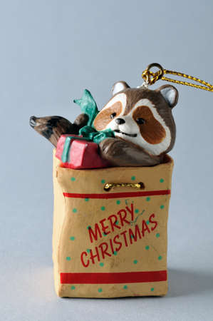 Raccoon .Ornament  of  Christmas tree. photo