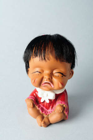 Oriental girl doll crying