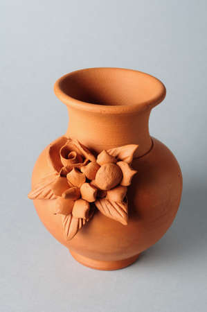 Ceramic vessel decorated with flowers photo