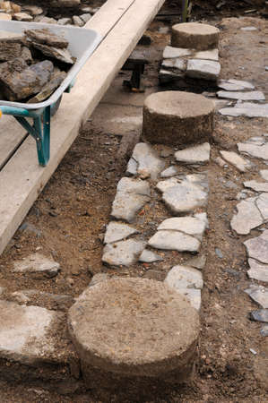 conserving: Working in the patio of the  Domus  Archaeological site  Chao Samartin  Asturias SPAIN
