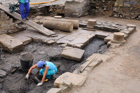 Working in the patio of the ' Domus ' Archaeological site ' Chao Samartin ' Asturias SPAIN
