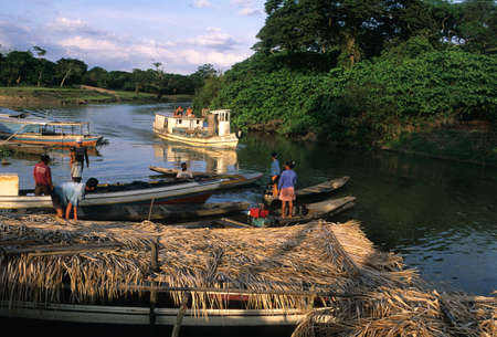 Fishermen at sunset on the river Camutins. Camutins MARAJO ISLAND (Amazon). BRAZIL