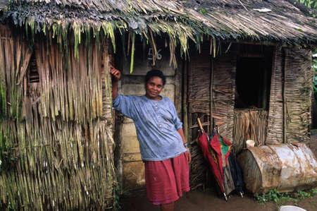 poorness: EQUATORIAL GUINEA. South Bioko. MOCA ; Women at the door of his house.