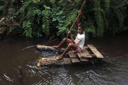 equatorial guinea: GUINEA ECUATORIAL. Continental  region .Monte Alen National Park ; Child raft. Editorial