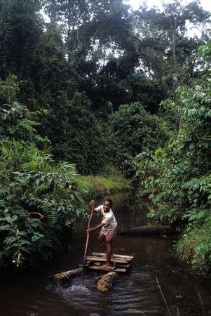 GUINEA ECUATORIAL. Continental  region .Monte Alen National Park ; Child raft.