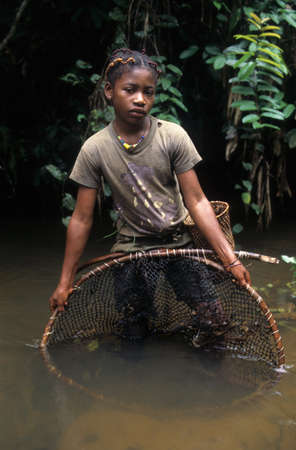 Fang girl with fishing net.  MONTE ALEN  National Park    Continental Region  EQUATORIAL GUINEA