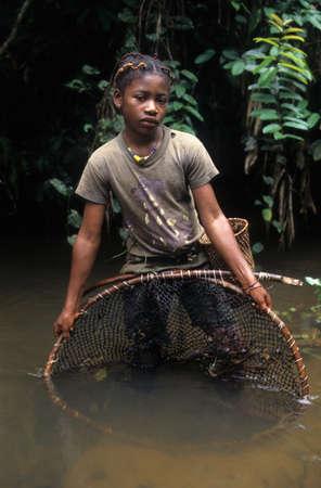 fang: Fang girl with fishing net.  MONTE ALEN  National Park    Continental Region  EQUATORIAL GUINEA