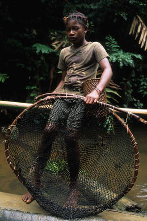 ancestral: Fang girl with fishing net.  MONTE ALEN  National Park    Continental Region  EQUATORIAL GUINEA