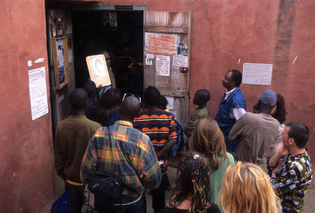 explanations: Guide giving explanations to visitors.  House Slaves  ( 18TH century )  GOREE ISLAND Dakar Region. SENEGAL.