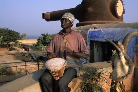 Young playing Djembe  GOREE ISLAND Dakar Region. SENEGAL.