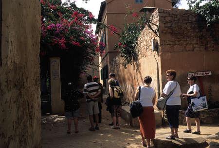 Tourists visiting Gor�e.  GOREE ISLAND Dakar Region. SENEGAL.