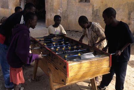 Children playing football GOREE ISLAND Dakar Region. SENEGAL.