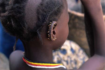 SENEGAL. Tambacounda Region   ( Bassari Country )  BEDIK     Village of Iwol   ;  Girl with porcupine quills in his ear