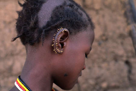 SENEGAL. Tambacounda Region   ( Bassari Country )  BEDIK     Village of Iwol   ;  Girl with porcupine quills in his ear.