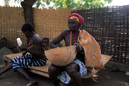 SENEGAL. Tambacounda Region  ( Bassari Country )  BEDIK    Village of Iwol   ; Women working.