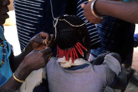 initiation: SENEGAL. Tambacounda Region  ( Bassari Country )  BEDIK    Village of Iwol  ; Woman preparing the boy for  Feast of the Initiation  Editorial