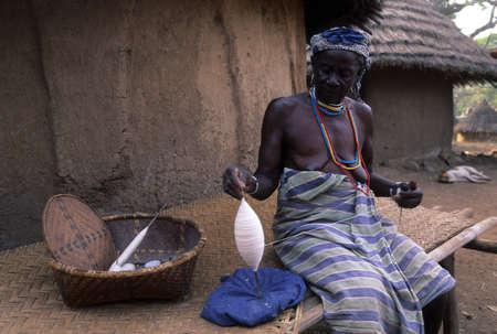 SENEGAL. Tambacounda Region  BEDIK Bassari Country  BEDIK  Village of Iwol  ; Old  woman spinning cotton
