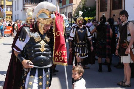 Roman Legionary talking to child   Astur-Roman Festival of  La Carisa   CARABANZO  Asturias SPAIN.