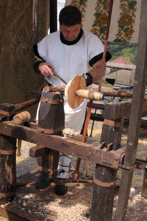 craftman: Manufacturing bowl lathe with birch wood   Astur-Roman Festival of  La Carisa   CARABANZO  Asturias SPAIN. Editorial