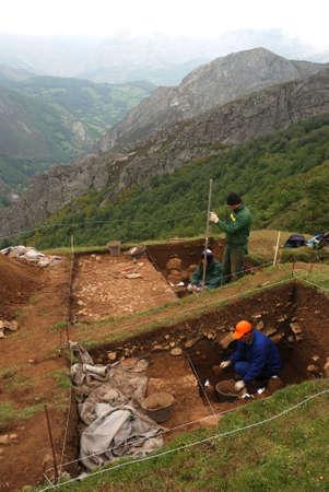 archaeologists: Archaeological excavation   Roman road  La Mesa    SOMIEDO    SPAIN                                                                Editorial
