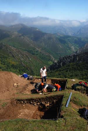 archaeologists: Archaeological excavation   Roman road  La Mesa    SOMIEDO   Asturias  SPAIN                                                                Editorial