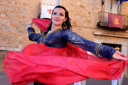 Dancing girl during the Medieval Festival of  CONSUEGRA  - Route of Don Quixote  ( Commemoration of the battle  ( 1097 ) .  Province of  Toledo . Castille- La Mancha SPAIN.