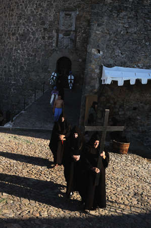 Friars in the initiation cermony of King Alfonso VI .Historical Recreation in the Castle during the Medieval Festival of  CONSUEGRA - Route of Don Quixote  ( Commemoration of the battle  ( 1097 ) . Castille- La Mancha SPAIN.                                Stock Photo - 12059135
