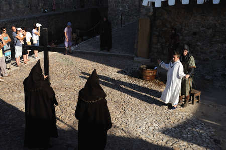 Friars in the initiation cermony of King Alfonso VI .Historical Recreation in the Castle during the Medieval Festival of  CONSUEGRA - .  Province of  Toledo . Castille- La Mancha SPAIN.                                                                       Stock Photo - 12059134