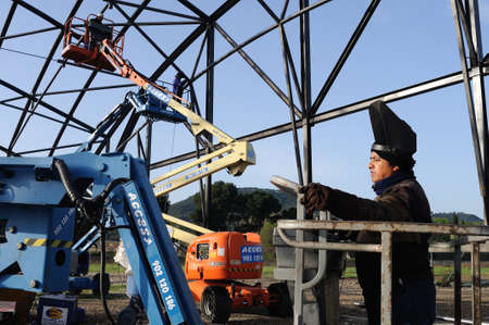 ALCALA DE HENARES , Spain - 04 April 2011- Welding . Construction of the Museum  House of Griffins    in the archaeological site of Complutum in ALCALA DE HENARES. Community of Madrid .SPAIN