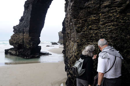 Couple looking at limpets