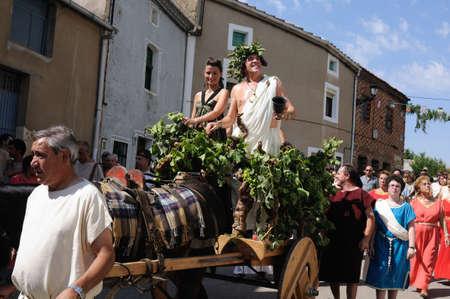 bacchus: SPAIN. Castilla y Le�n .Burgos .Ba�os de Valdearados .    FEAST of BACCHUS  ; Parade of Bacchus and Ariadne his wife in a car through the streets of the town.