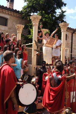 bacchus:  SPAIN. Castilla y Le�n .Burgos .Ba�os de Valdearados .    FEAST of BACCHUS  ; Bacchus giving a speech on a stage classic in the main square.